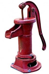 old fashioned red water pump
